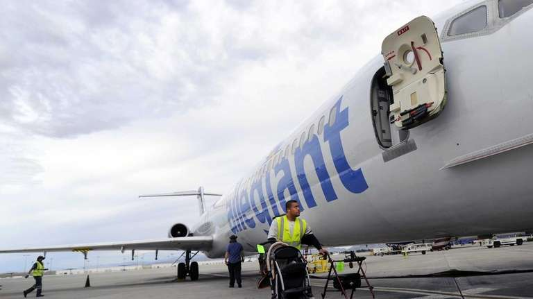 Ramp agent Vince Divon retrieves gate-checked items of