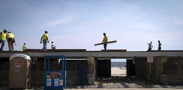 Construction workers continue to rebuild the Long Beach