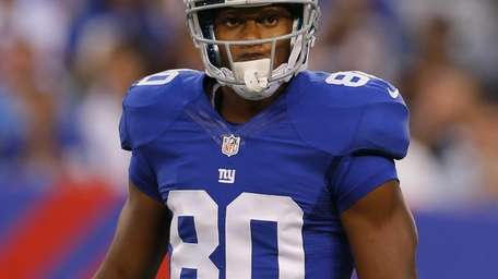 Victor Cruz looks on during a game against