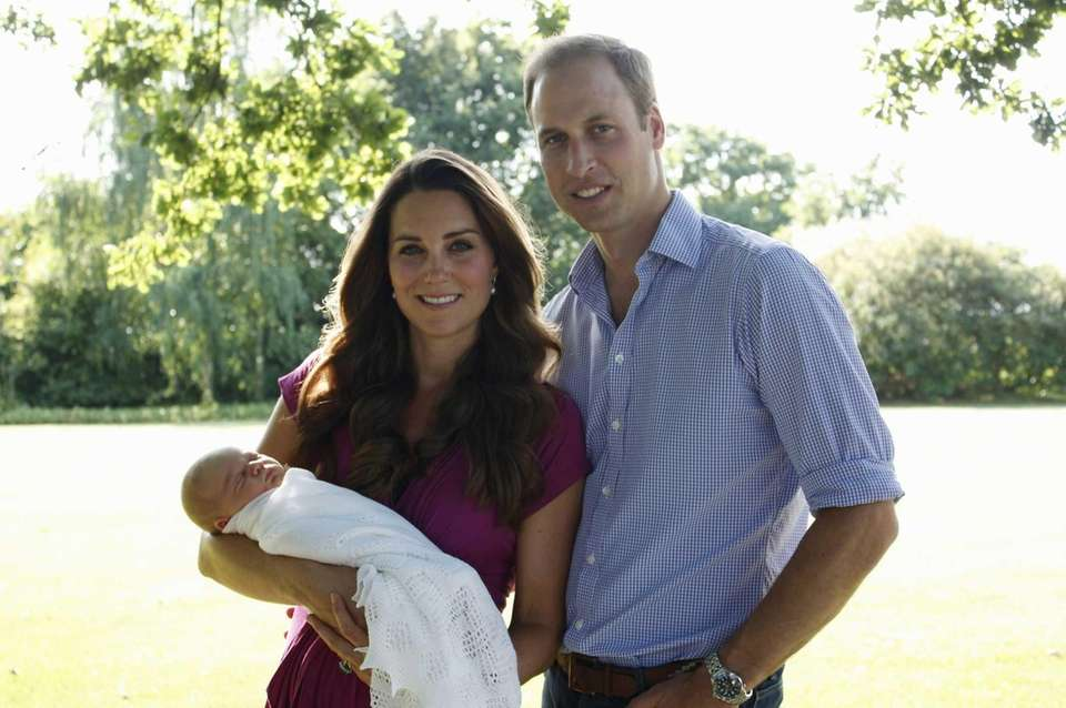 Prince William, Duchess Catherine with Prince George of