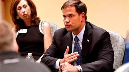 Sen. Marco Rubio, R-Fla., talks with business leaders