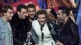 "*NSync accepts the ""Best Pop Video"" award for"