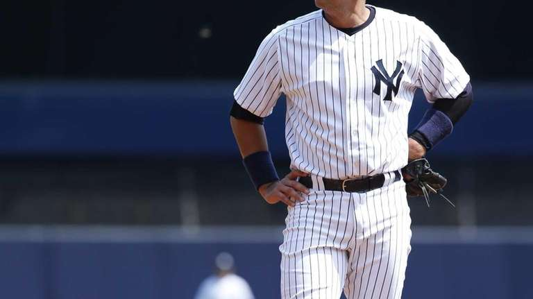 Alex Rodriguez stands at third during the first