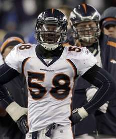 Denver Broncos outside linebacker Von Miller walks along