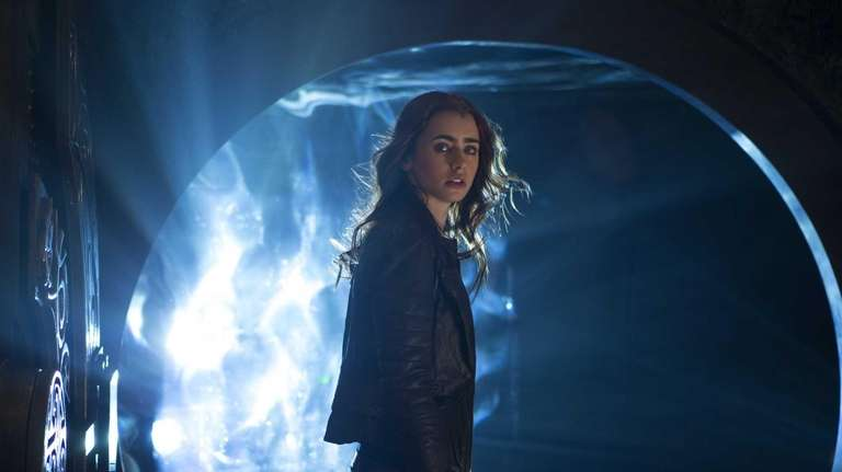 Lilly Collins as Clary in