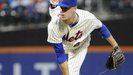 Zack Wheeler delivers a pitch during a game