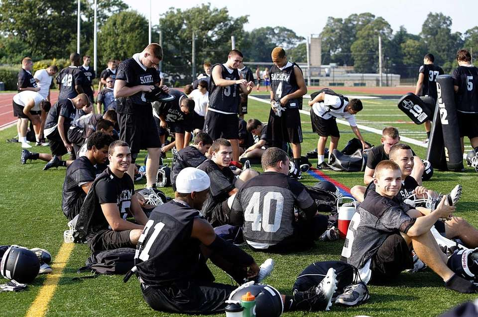 Sachem North players suit up for practice. (Aug.