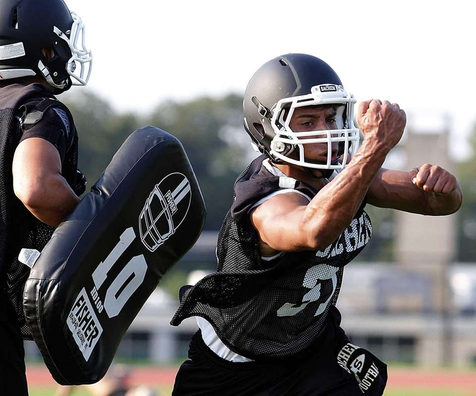 Sachem North players perform drills. (Aug. 20, 2013)