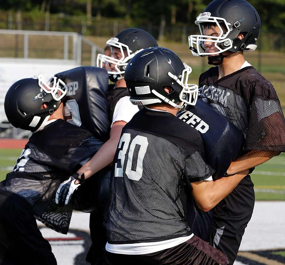Sachem North players perform blocking drills. (Aug. 20,