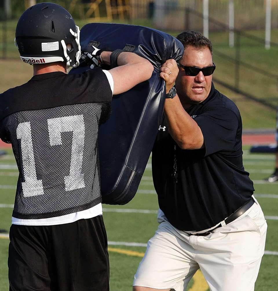 A Sachem North coach shows the proper technique