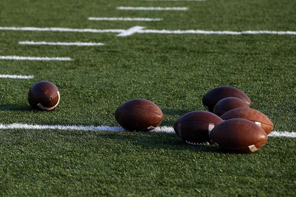 Footballs lay on the field during Sachem North