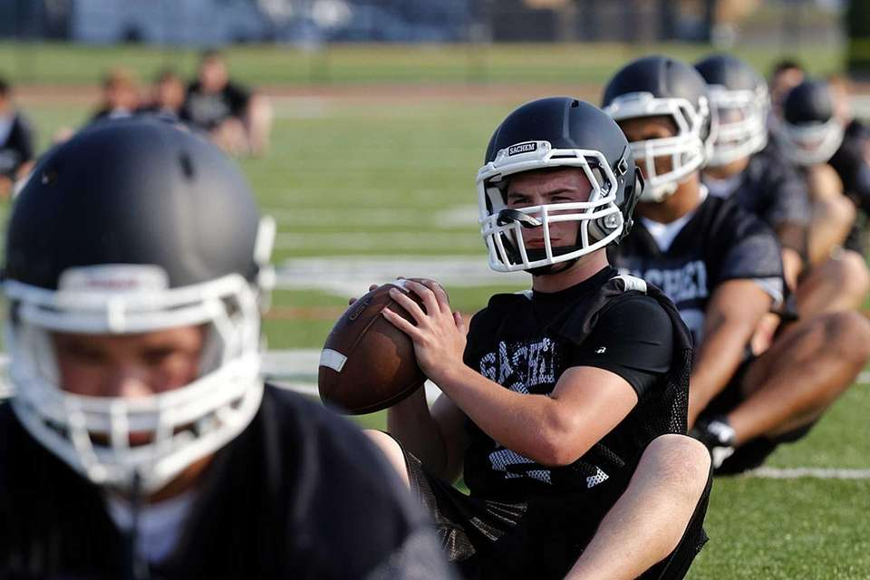 Sachem North practice begins with stretching. (Aug. 20,