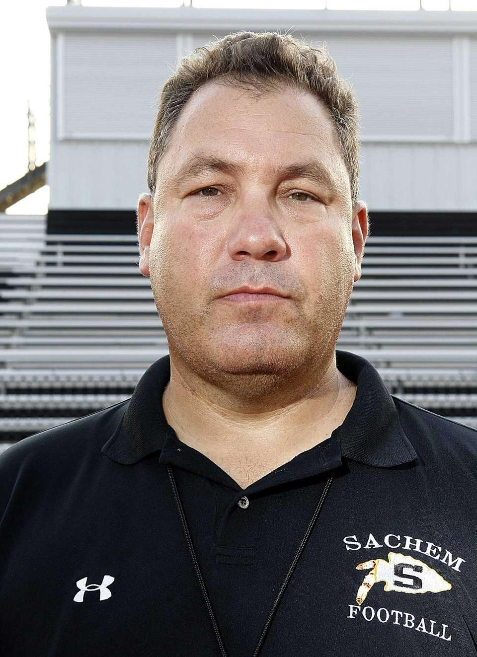 Sachem North Football head coach Dave Falco poses