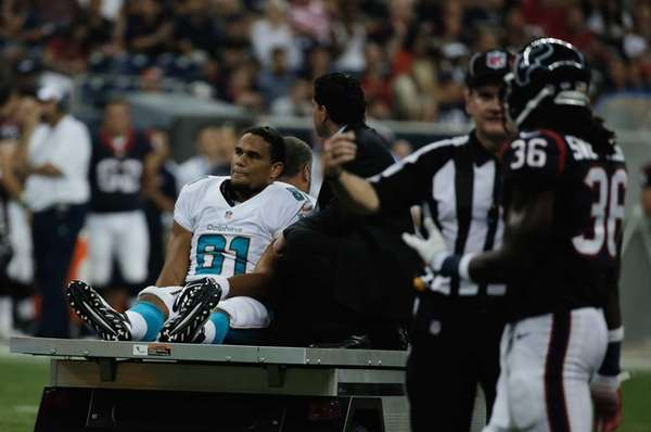 Dustin Keller of the Miami Dolphins is carted