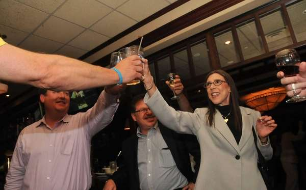 Carol Meschkow, of Plainview, right, leads a toast