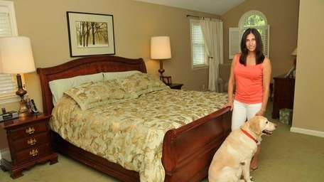 Bonnie Young, pictured in her bedroom with her