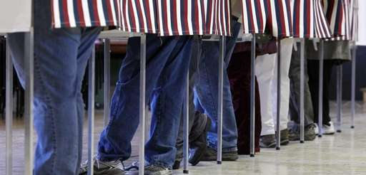 Residents vote for their candidates at a voting