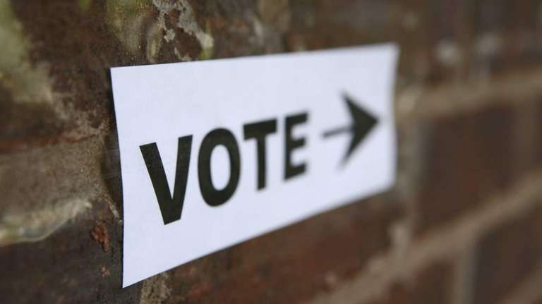 Signs direct voters to polling stations.