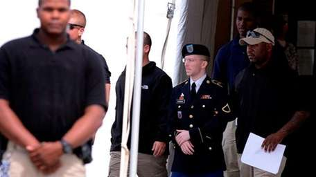 Bradley Manning is escorted out of the courthouse