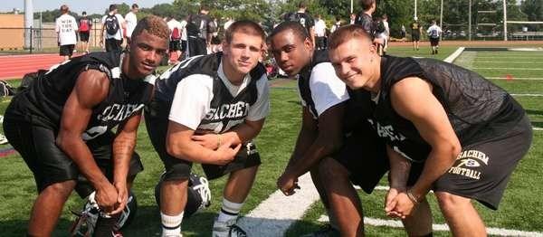 Sachem North football players, from left: Kevin Bragaglia,