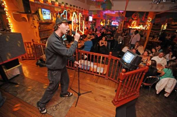 Shawn Sisti of Bohemia belts out a karaoke