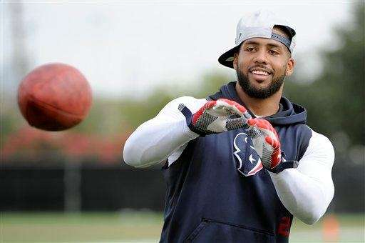Houston Texans running back Arian Foster goes through