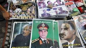 Posters showing Egyptian Army Chief Lt. Gen. Abdel-Fattah