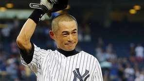 Ichiro Suzuki of the Yankees salutes the crowd