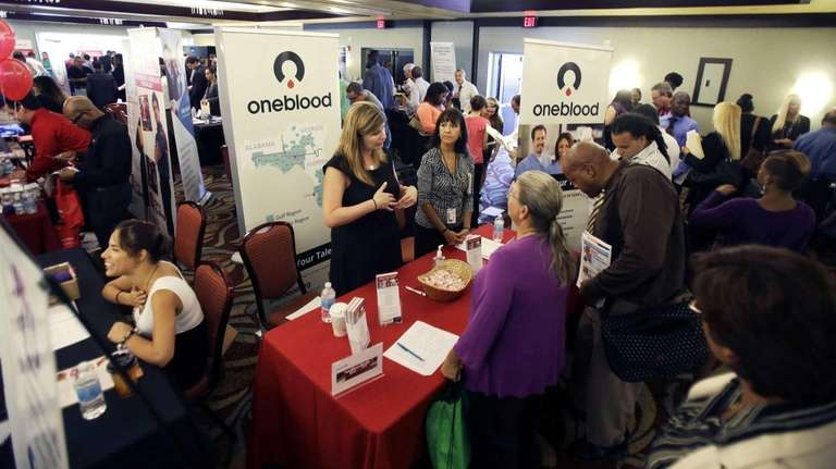 Job seekers check out companies offering more than