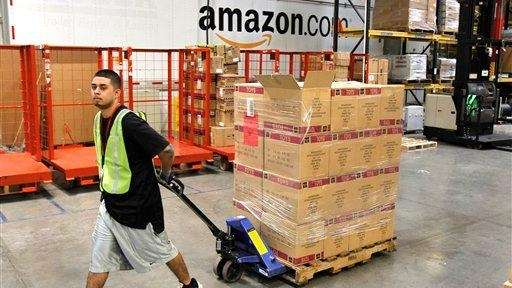 Humberto Manzano, Jr. delivers an arriving pallet of