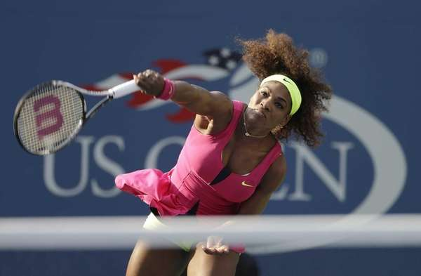 Serena Williams serves to Spain's Maria Jose Martinez
