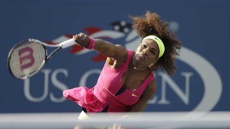 Serena Williams serves to Spain's Maria Jose Martinez