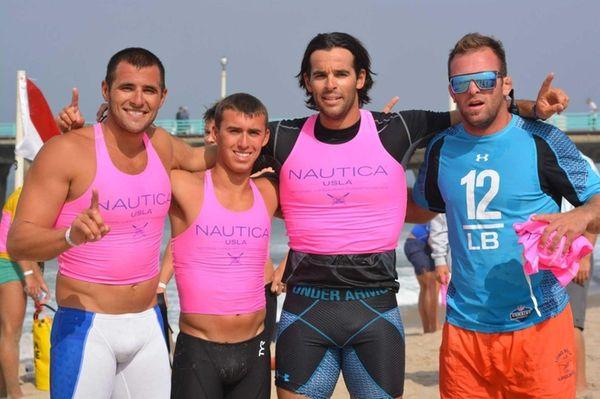 From left, Long Beach lifeguards Tim Cabasino, 22,