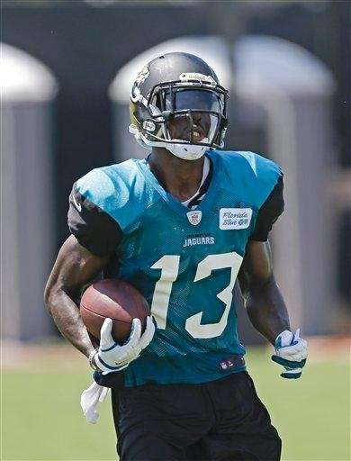 Jacksonville Jaguars wide receiver Mohamed Massaquoi runs after
