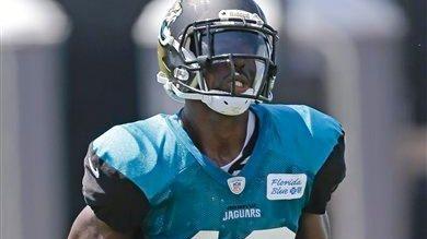Jacksonville Jaguars wide receiver Mohamed Massaquoi runs after