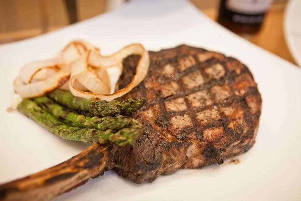 A bone-in ribeye steak from David Burke's Champions