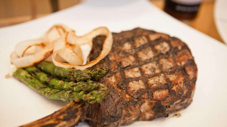 A bone-in ribeye steak from David Burke's Champions