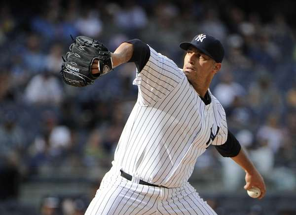 Yankees starting pitcher Andy Pettitte delivers against the