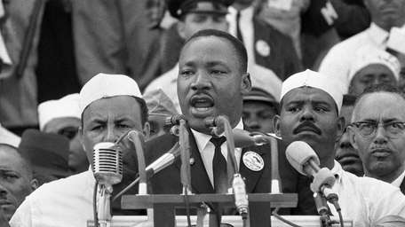 The Rev. Martin Luther King Jr., above, during