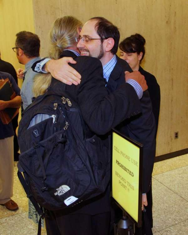 Jesse Friedman hugs his attorney, Ronald Kuby, after