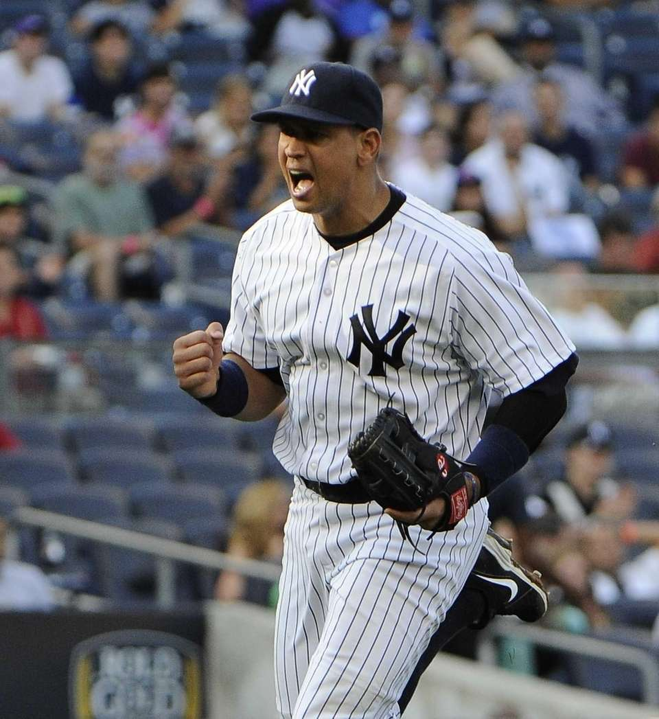 Yankees' Alex Rodriguez reacts after throwing to first
