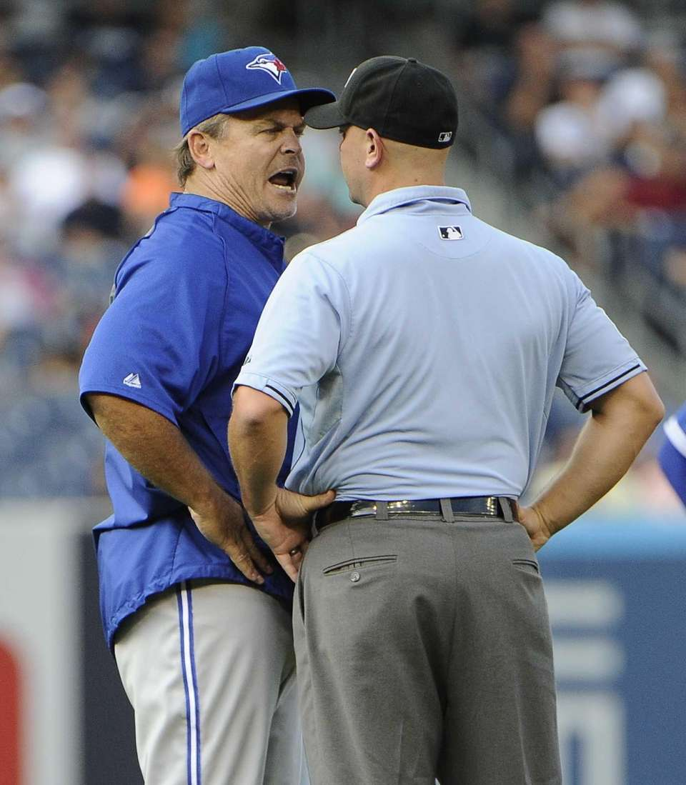 Toronto Blue Jays manager John Gibbons argues a