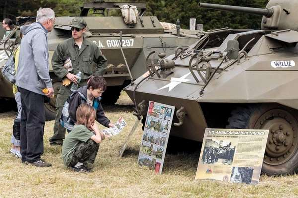 Visitors look at some of the historical tanks