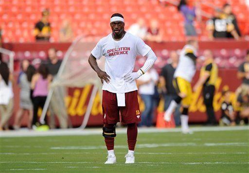 Washington Redskins quarterback Robert Griffin III runs during