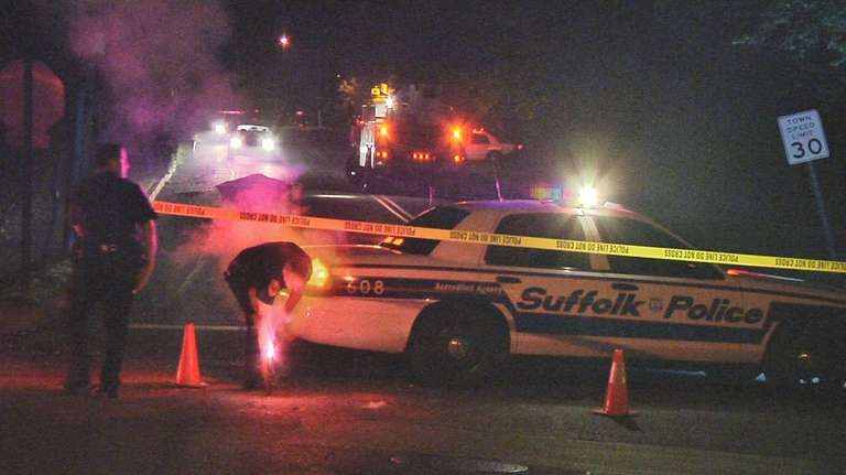 Suffolk County police vehicular crime unit detectives investigate