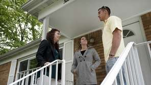 Realtor Courtney Dunford, center, shows a home to