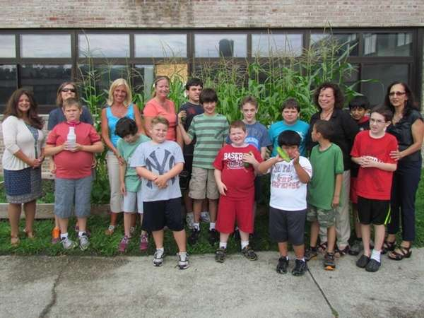 Participants in the Grounds for Change program plant