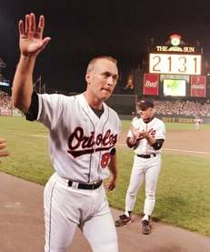 Oriole Cal Ripken salutes crowd at start of