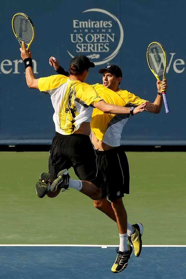 Bob and Mike Bryan celebrate match point against