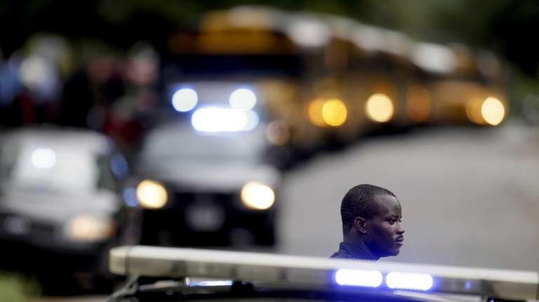 A Dekalb County Police officer stands guard as